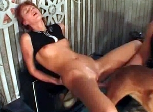 Redheaded slut is banged hard in this video